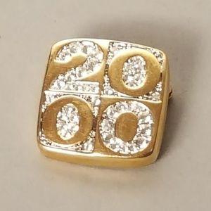 "Monet ""2000"" crystal gold tone brooch"